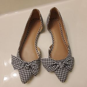 Black and White checkered slip on shoes.